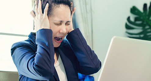 Woman reacts to network downtime