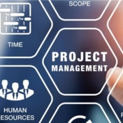 Man in background pointing to project management graphics