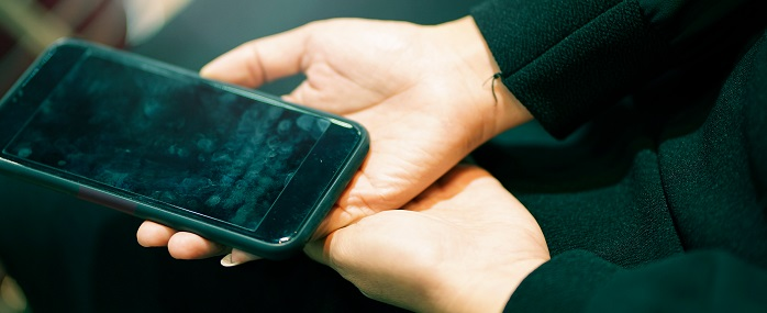 Dirty Phone held in a woman's hand