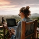 Woman on Laptop with View